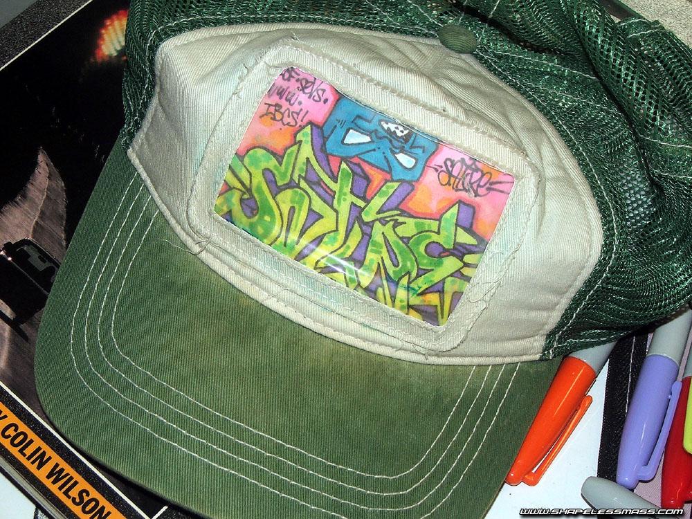 awww.shapelessmass.com_snm_wp_content_visuals_blackbook_green_hat.jpg