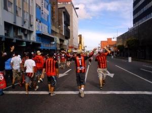 Some guys of the barra brava walking at San Jose