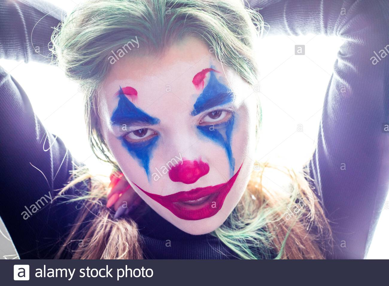 portrait-of-a-girl-with-clown-makeup-isolated-on-white-background-2ADTP96.jpg